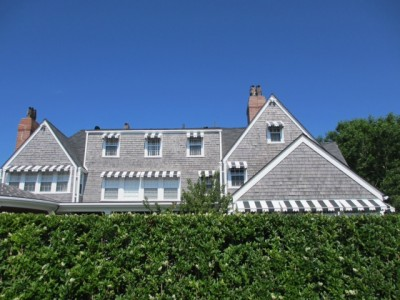 Grey shingled house with Striped awnings in sconset